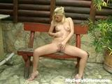 Horny Co-Ed Strips Nude In The Backyard